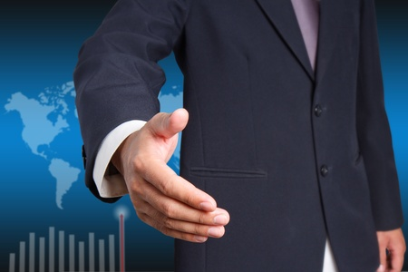 Businessman offering for handshake  on world background