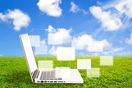 Laptop on grass and virtual buttons interface Stock Photo - 12661404