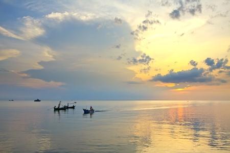 Fishing boat sunrise, huahin thailand photo