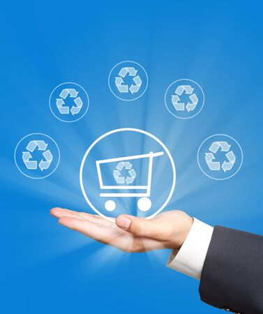 shopping cart and recycle icon on business hand Stock Photo - 12661808
