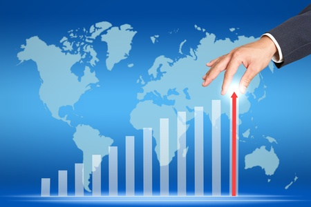 financial gains: hand and business graph Stock Photo