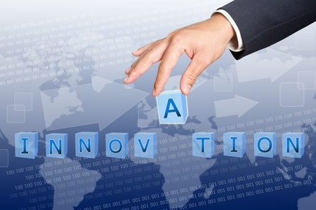 hand of business man Hold  innovation word buttons  Stock Photo