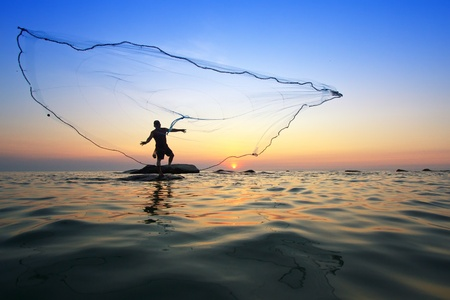 throwing fishing net during sunrise, Thailand Stock Photo - 12916945