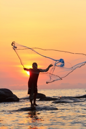fishing net: throwing fishing net during sunrise, Thailand