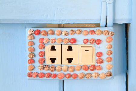 power outlet and light switch decoration with sea shell photo