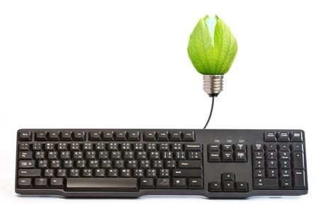 Energy saving light bulbs and  back keyboard. Stock Photo - 12916529