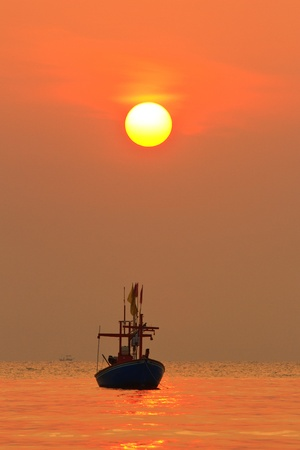 Fishing Boat at Sunrise photo