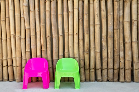 Plastic chairs on Japanese bamboo background photo