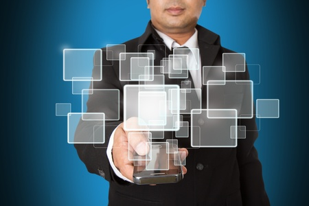 Hand of Business Man Pressing or Pushing touch screen of Mobile Smartphone Stock Photo - 13056733