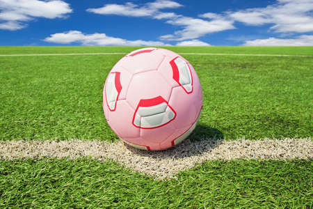 Football or soccer ball on a green lawn - outdoors photo