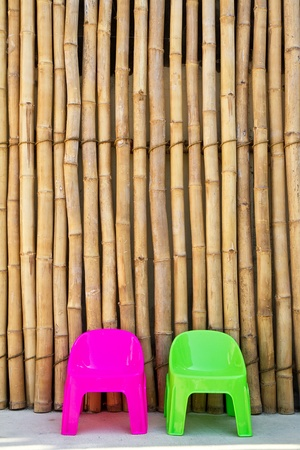 Plastic chairs on Japanese bamboo background Stock Photo - 13056832