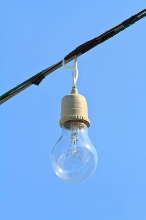 Light bulb on blue sky photo