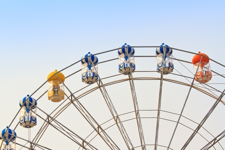 ferris wheel against a blue sky  photo