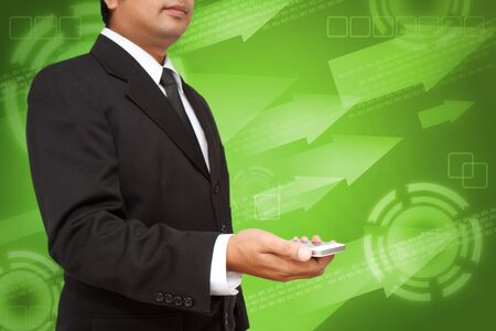 Business Hand holding smart phone with green digital background photo