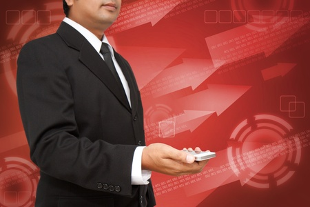 Business Hand holding smart phone with red digital background photo