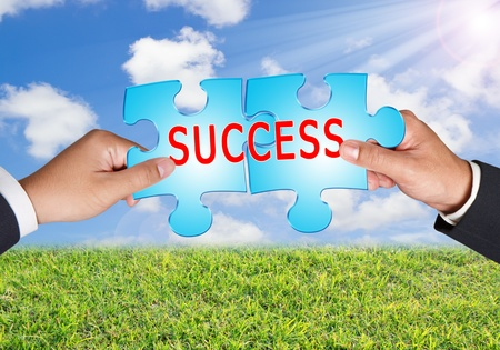 Business hands and puzzle success on blue sky Stock Photo - 13231790