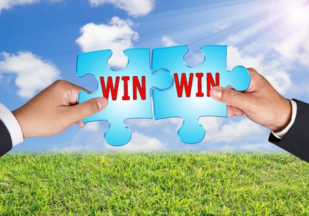Business hands and puzzle win win on blue sky Archivio Fotografico