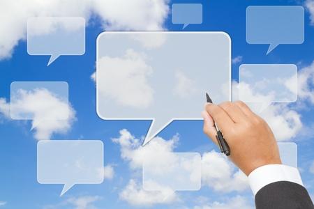 Businessman  writing  text balloon on blue sky Stock Photo - 13230646