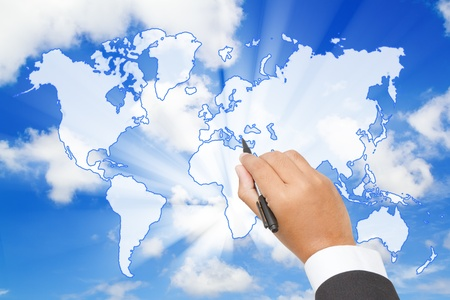 Businessman Draw a world map  on blue sky photo