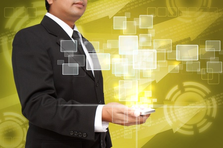 Hand of Business Man Pressing or Pushing touch screen of Mobile Smartphone Stock Photo