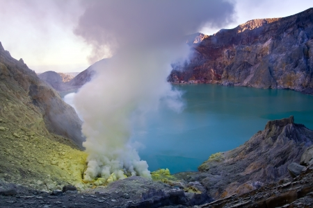 Extracting sulphur inside Kawah Ijen crater, Indonesia Stock Photo