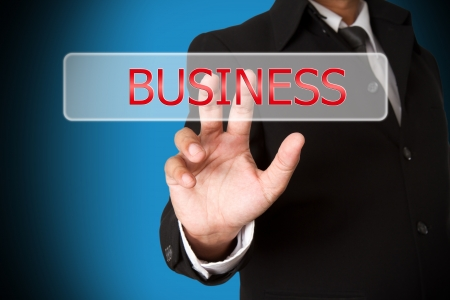 business hand pushing the business  virtual button as concept photo