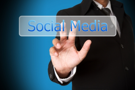 business hand pushing the social media  virtual button as concept photo