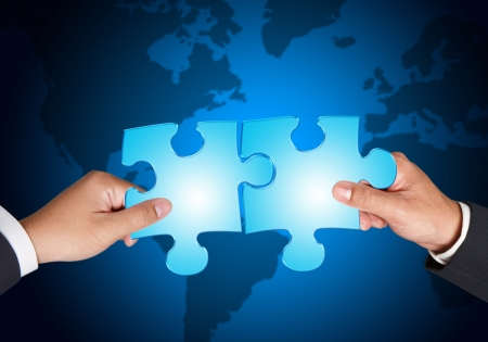 Business hands and puzzle  Stock Photo