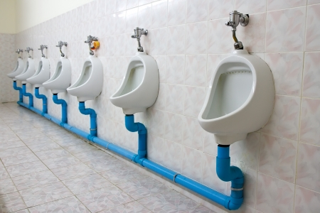 Row of four urinals photo