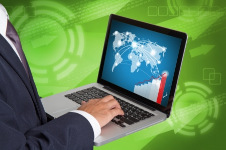 businessman working with laptop and business graph photo