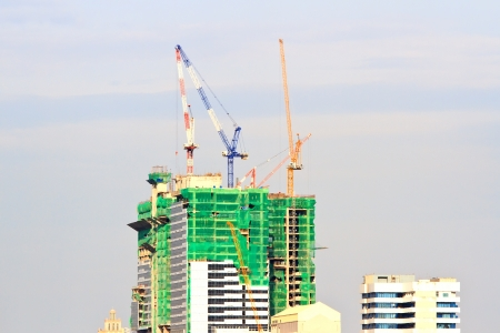 Big Construction Site with Working Cranes at dusk for Business Background photo