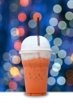 iced milk tea with light bokeh background photo