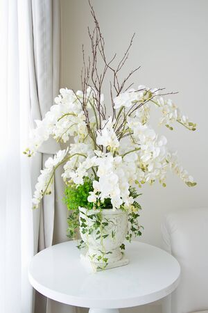 white vase and flowers photo