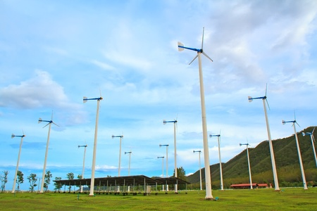 green meadow with Wind turbines generating electricity photo