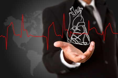 Business man  holding Heart and heart beats cardiogram photo