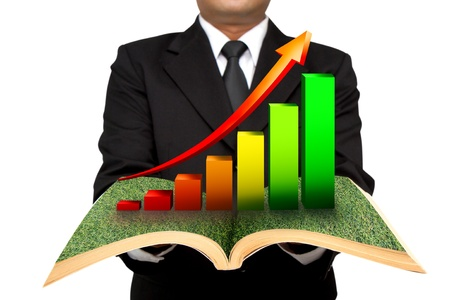 Businessman hold graphs  open book photo