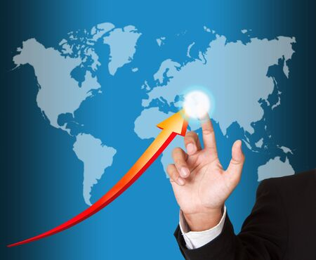 Hand pointing arrows on world map Stock Photo - 15426698