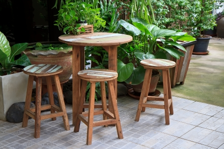 Aerial shot of wooden table and chairs - garden furniture  photo