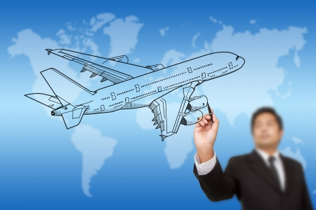 Businessman Drawing Airplane for travel around the world. photo