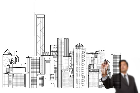 construction management project: businessman drawing a city