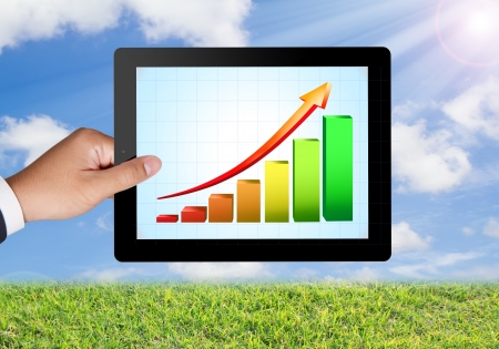 Business hands Hold Colorful graph on a tablet  Stock Photo - 16253437