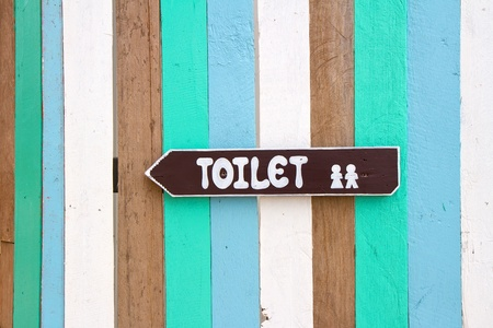 Toilet signs on the colorful wood wall background photo