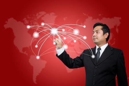 Businessman pressing modern social network on a virtual background photo