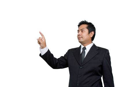 Successful young business man pointing at something interesting against white background photo
