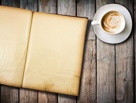 coffee and old  book on wood table photo