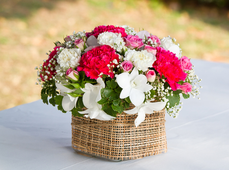 mixed flower bouquet: beautiful bouquet of bright wildflowers in basket Stock Photo
