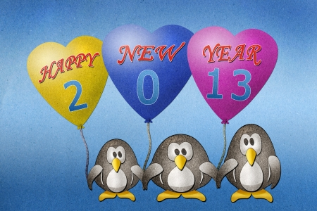 Penguins hold balloon 2013  paper craft on paper background photo