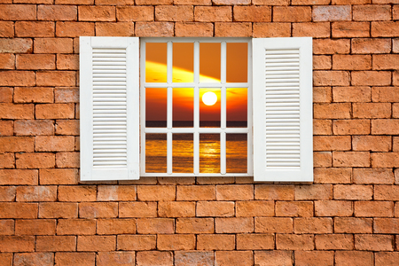 Red brick wall  with window seaview photo