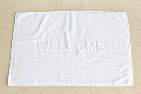 welcome mat: White welcome mat made from fabric Stock Photo