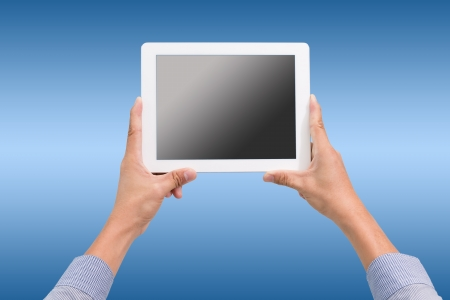 hands holding a tablet touch computer gadget with isolated screen photo